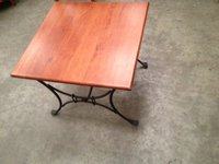 Hardwood Coffee table with intricate Steel legs