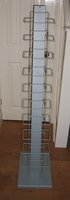 Literature rack made of steel and sprayed light grey