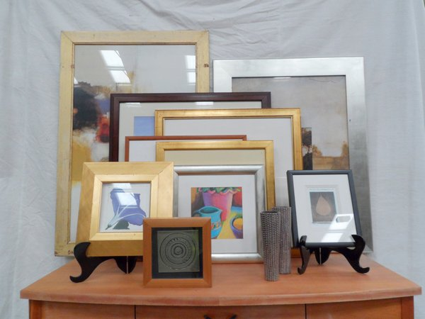 assortment of frames and prints