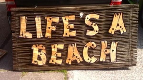 Lifes a beach sign