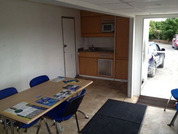 exhibition trailer kitchen and seating area