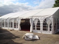 Framed marquee with window walls