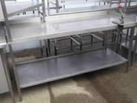 Stainless steel table with Banza can Opener