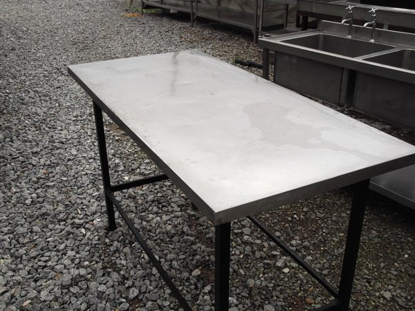 Stainless steel table on iron legs