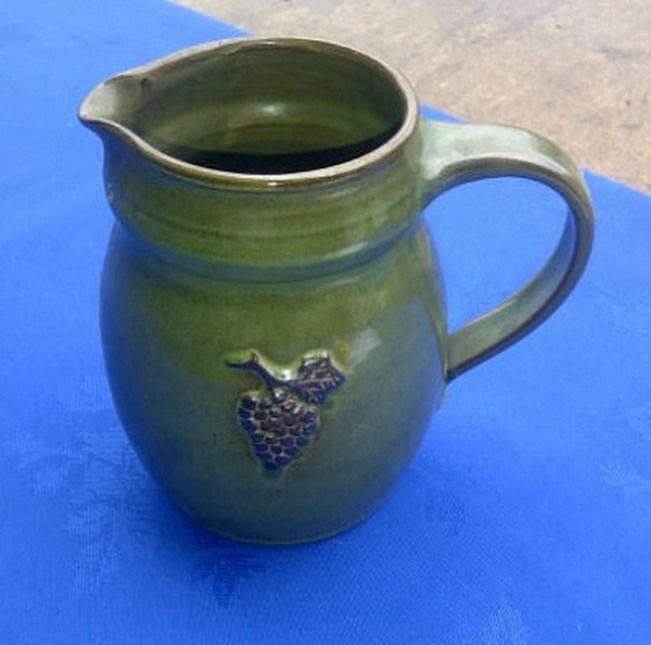 green pottery jug