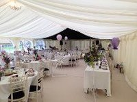 Chairs and table inside framed marquee
