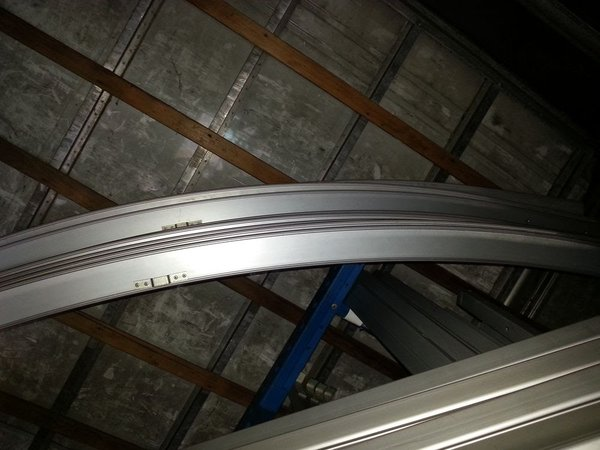 Curved marquee roof beams