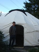 Black topped yurt with white canvas cover