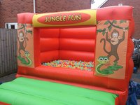 Jungle bouncy castle with ball pool balls