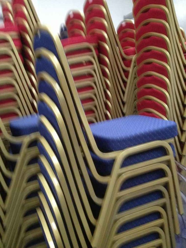 Stacked Red banquet chairs
