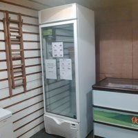 Framec upright display freezer with shelves.