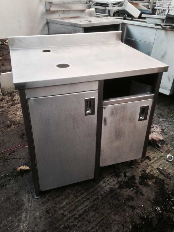 Stainless steel prep table with cupboards