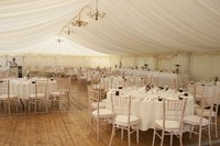 Framed marquee with flooring and tables