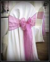 Round chair cover with pink sash