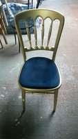 Stackable, gold gilt beech spindle back dining chairs.