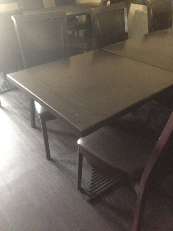 Cast Iron Step Base and Werzalit Plus Square Table Tops