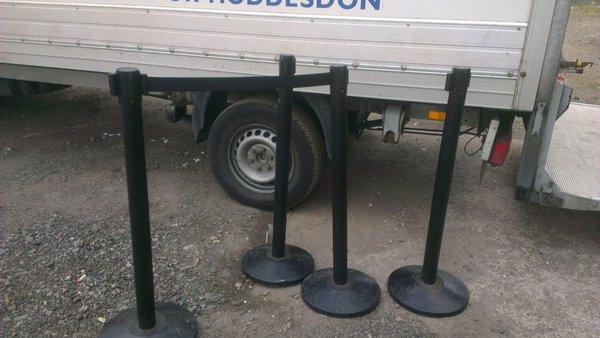 4 black poles