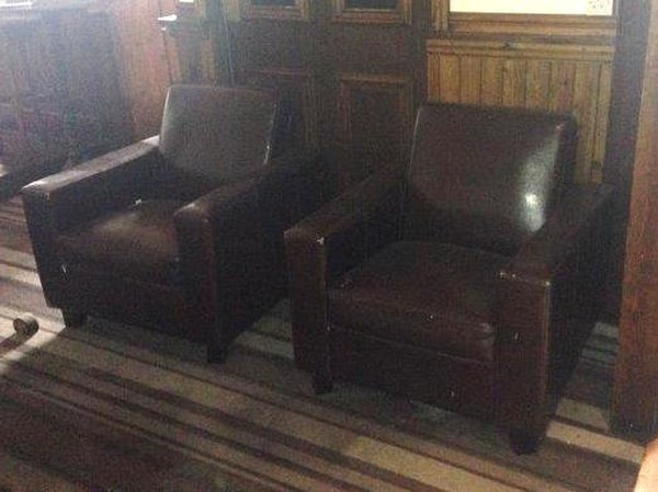 2x brown leather arm chairs