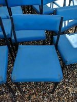 Blue stacking chairs