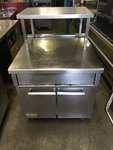Stainless steel table with storage
