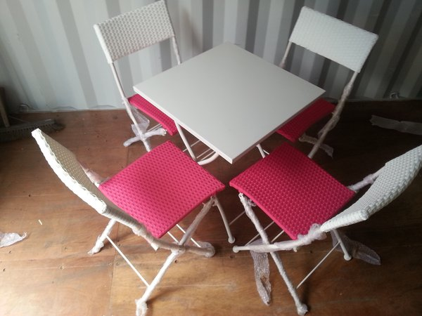 folding metal tables each with 4 folding chairs