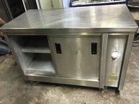 Stainless steel hot cupboard on wheels.