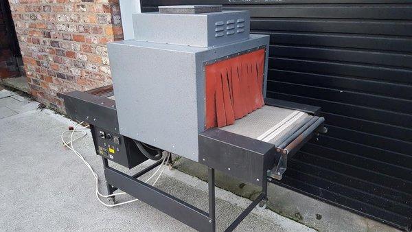 John Quinn Heat Shrink Packing Machine