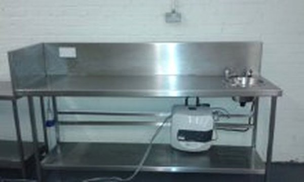 Stainless Steel Table with handwash, heater and shelves