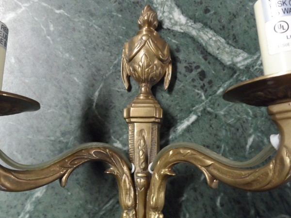 Classic urn / torchere brass wall sconces.