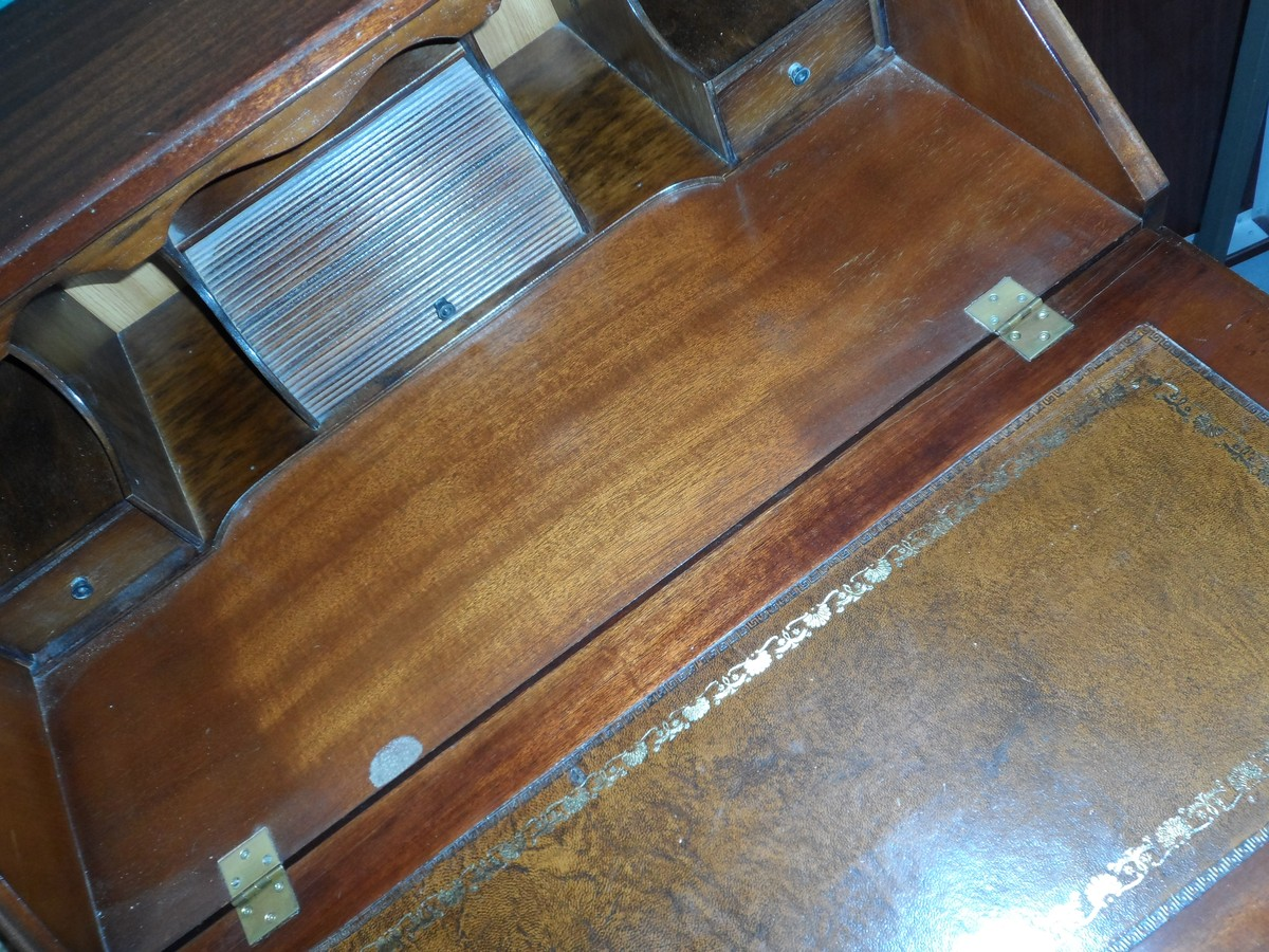 writing bureau A desk or bureau is a piece of furniture with a flat table-style work surface used in a school, office, home or the like for academic, professional or domestic.