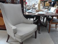 High wing backed chair