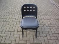 Black dining chair with seat pad