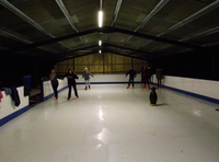 Ice Magic Synthetic Ice Skating Rink and Equipment