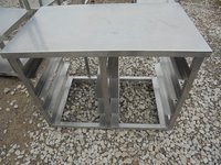 Stainless steel table with tray storage racks