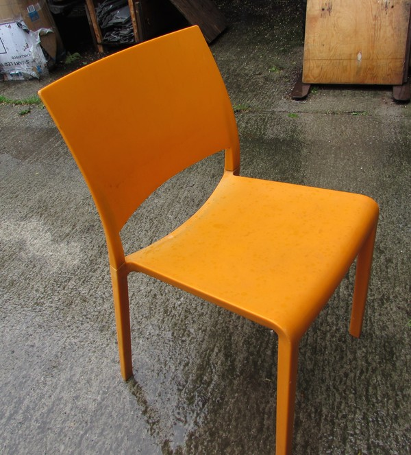 Stacking Josep Llusia Orange Chairs