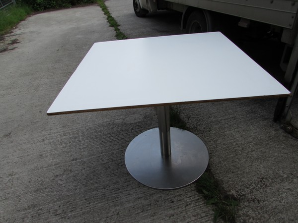 Large white cafe tables