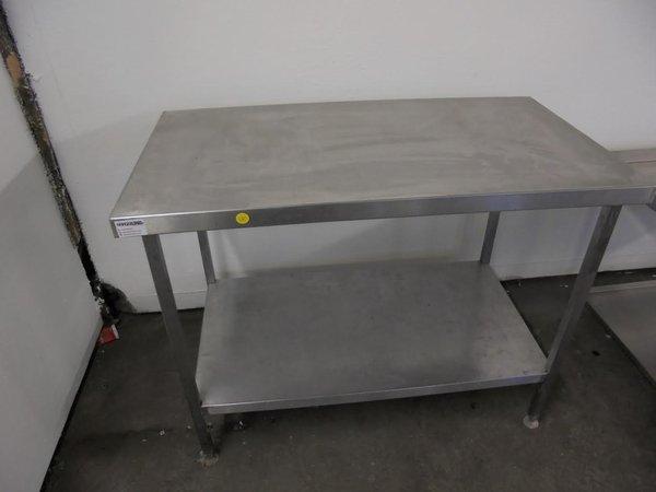 Stainless steel table.  Shelf. Adjustable feet.  120cm