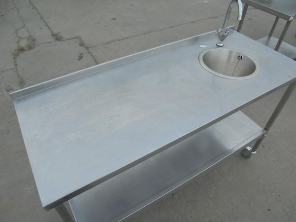 Stainless steel table with sink and taps