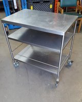 Stainless steel table    60d x 90w x 85h   On wheels