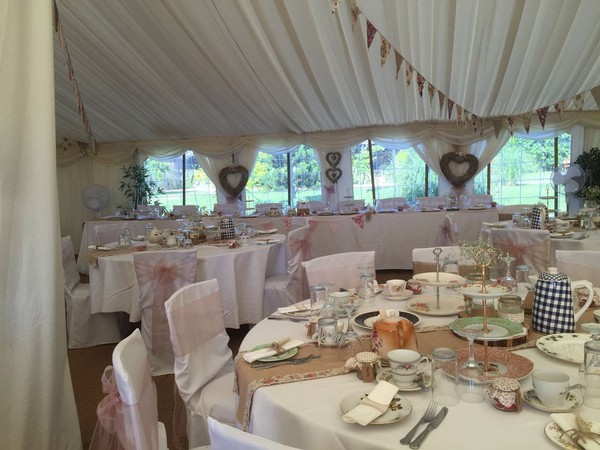 Round tables set out for a wedding