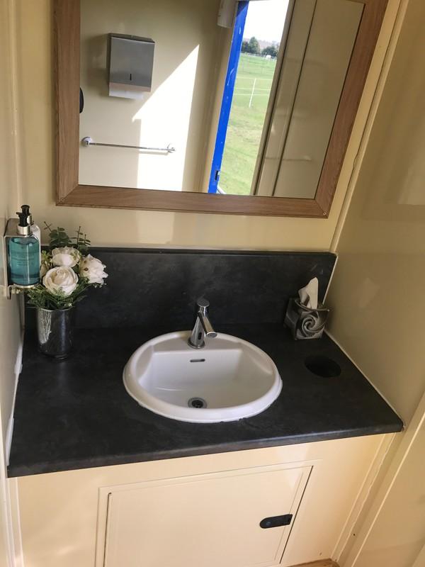 Toilet trailer sink