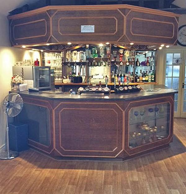 Handbuilt wooden bar with ceiling
