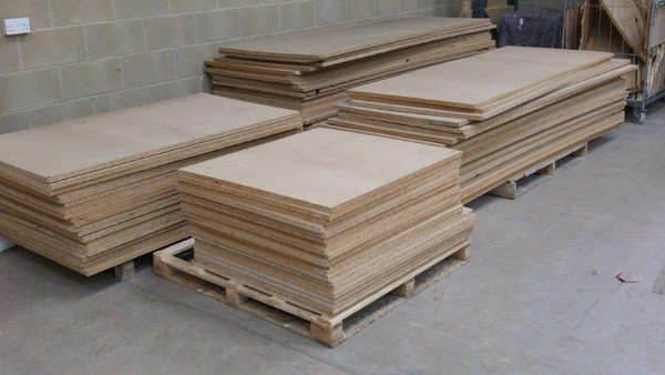 Chipboard shelves for pallet racking