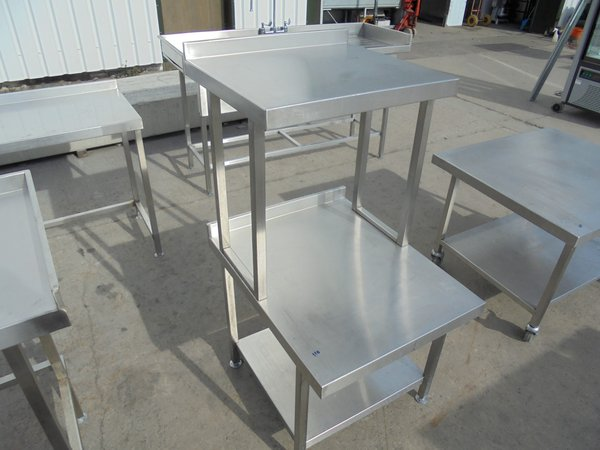Stainless steel table with over shelf.