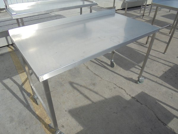 Stainless steel table on casters.