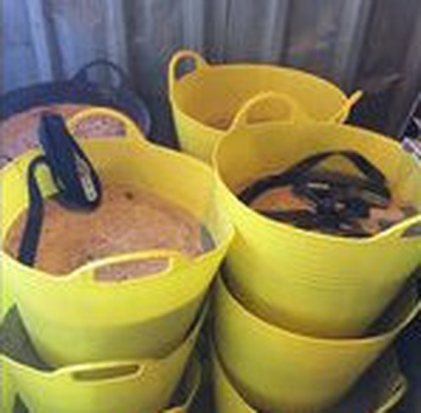 Concrete weights in yellow buckets with ratchet strap