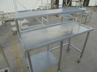 Used stainless steel table and gantry shelf