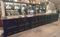 Dark arched bar for sale