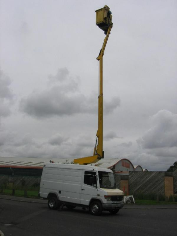 Van with cherry picker