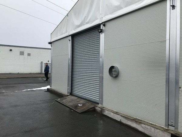 Roller shutter door for a framed marquee